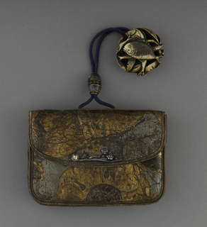 A purse with a front flap made in leather. Two small metal flowers lay over the opening flap with a small mouse. The strap is made out of a blue cord with one enameled brass bead and an abstract circular brass pendant.