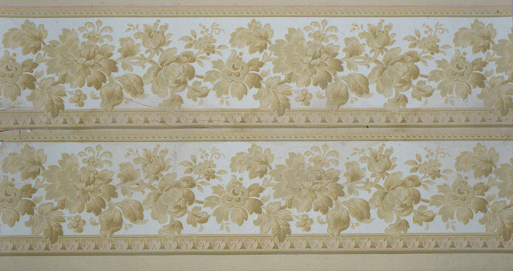 On light gray ground, beige and light brown flowers in allover pattern in two registers.