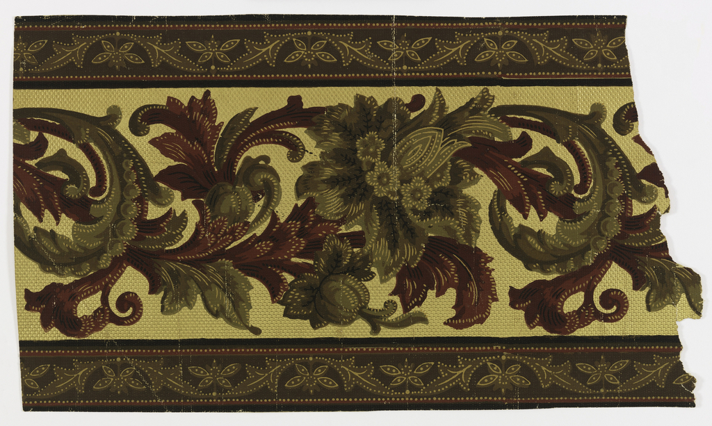 Frieze on paper embossed with textile weave pattern, brown, green and off-white floral motif interspersed with scrolled red and green foliage; top and bottom banding consists of brown ground, brown and off-white abstract flower and leaf motifs bordered in red with off-white dots. Printed on metallic gold ground.