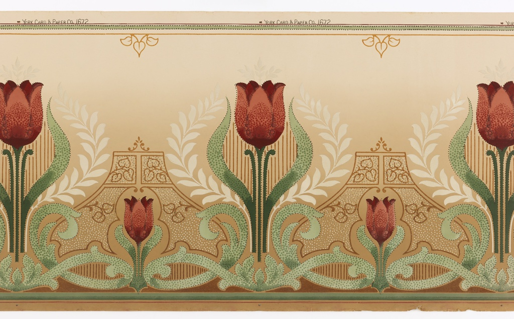 """Mission style. Alternating large and small stylized red tulips. The large tulips are enveloped in cream laurels. The small tulips are enframed in a polka-dotted structure outlined in a dark brown glossy pigment. Bottom has scrolling vine and band of glossy brown pigment. Top is a band of green with beading and a brown glossy band with widely spaced three-leaf clusters. Lower half of background ornamented with dots and vertical stripes. Ground shades dark to light beige, bottom to top. Printed in selvedge: """"York Card & Paper Co""""; pattern number """"1672""""."""