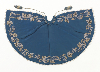 "Small cape for an ecclesiatic figure, the ""Bambino"". Blue silk grosgrain with grapevine design embroidered in white and cream coloured glass beads and silver sequins along the edge. Lined with blue silk twill."
