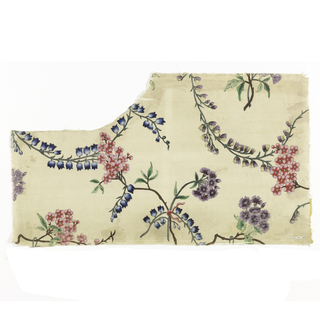 White ground with a central spray of blue bells, cherry blossoms and purple fringed flowers caught together with a red ribbon. Bluebells, cherry blossoms and purple and yellow flower sprays curving toward the central group. Portion of right selvage present on both pieces.