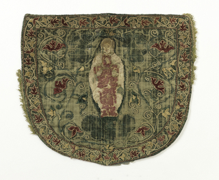 Green velvet with applique showing the Virgin and Child (?) surrounded by scrolling vine and leaves. Lined with heavy linen.