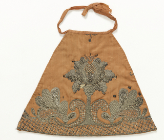 Apron for an altar figure in pink satin embroidered in silver thread. With 1949-83-2 forms costume for figure of Infant Jesus.