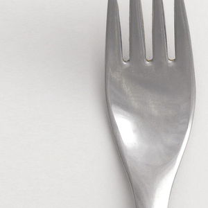 Dinner fork four-tined with slightly tapering, curved handle with rounded, square terminal, rectilinear handle, ovoid bowl.