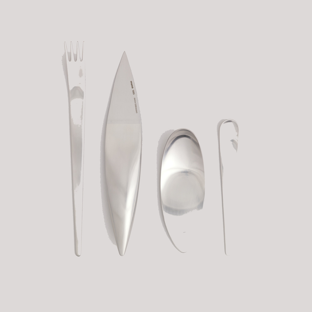 Four-tined fork with flat, narrow handle tapering towards curved terminal.