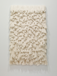 Rectangular panel of irregularly overvapping tassels of  white linen.
