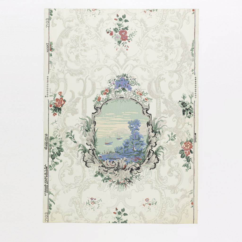 "A drop repeat design consisting of an oval medallion depicting a seascape with two sailing ships: a portion of the shore in foreground. It is a small reproduction of a scene taken from a large panel of a scenic paper. The background has Rococo scrolls in grisaille and tiny nosegays in color scattered about. Background of paper is polished. The original scenic panels were in an old mansion belonging to a sea captain in Lynn, Massachusetts. Printed in selvedge: ""7103 Strahan, Made in U.S.A."" Printed in shades of red, blue, green and gray on white field."