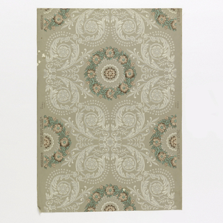 "A small floral rosette is encircled in a wreath of flowers which in turn has a large wide border simulating a lace pattern composed of scrolls and printed in ivory. Named for painter James McNeil Whistler, who lived for a time in the ""Old Corner House"" in Stonington, Connecticut, which was owned by his aunt Mrs. Palmer. Printed in ivory, gray, green and peach on putty-colored field."