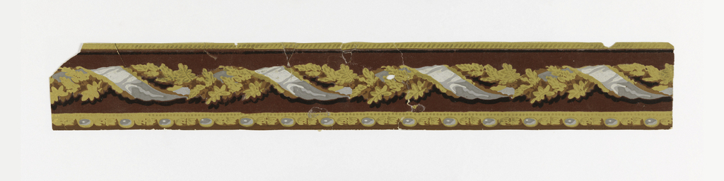 An intertwined cable of a ribbon and foliage against a deep red flocked background. The bottom edging consists of a bead and reel molding. Printed in gold, metallic gold, maroon flocking, blues, brown and gray.  H# 88