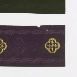 Metallic gold quatrefoil medallion printed on flocked background. The flock is overprinted with edge bands of a ribbon twist on rod. a) Printed on green flock ground; b) Printed on purple flock ground.  H# 35B