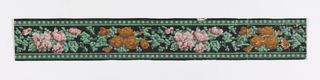 Central band of tapestry or cross-stitch imitation. Alternating motifs of pink and orange flowers, separated by foliage. Narrow bands of small squares along top and bottom edges. Printed on black ground.  H# 26