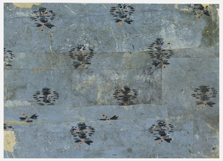 Simulated moire silk, decorated with small bunches of flowers in drop repeat. Printed in colors on light blue ground.
