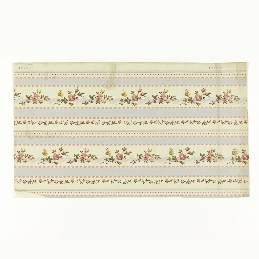 Full width. Simulation of brocade of Louis XVI period. Wide and narrow stripes of blue and pink, and alternating large and small serpentine vines with flowers. Paper embossed with transverse ribbing. Printed in blue, green, yellow and pink on white ground.