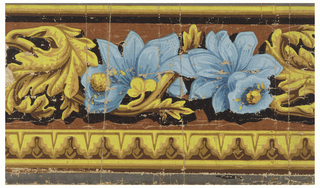 Incomplete repeat of design of acanthus leaves and jonquils, above a simulated leaf molding. Printed in yellows, browns, and blue on Indian red ground.