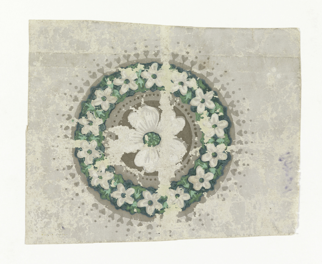 Design consists of a single circular medallion or rosette containing a five petalled flower in off-white with a green center. This center motif is enclosed with a similar flower with green centers but in a smaller scale. There are fourteen flowers in this outer band which in turn has a tiny heart and dot border in putty color.