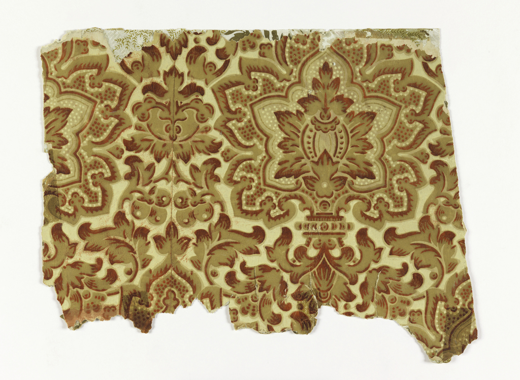 Many small pieces of two different designs: a) largest piece, Aesthetic style with very dense pattern. Large foliate medallions with stylized foliage and berries or fruit. Printed in red, yellow and tan on a yellow ocher ground; b) appears to be another Aesthetic style pattern, with small-scale vining floral and berries. Printed in red, green and yellow on taupe ground.