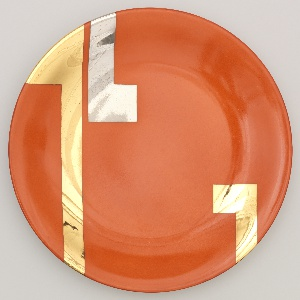 Round plate with orange-red enamel ground on front, and with two wide L-shaped gilt bands and one wide L-shaped motif in platinum.