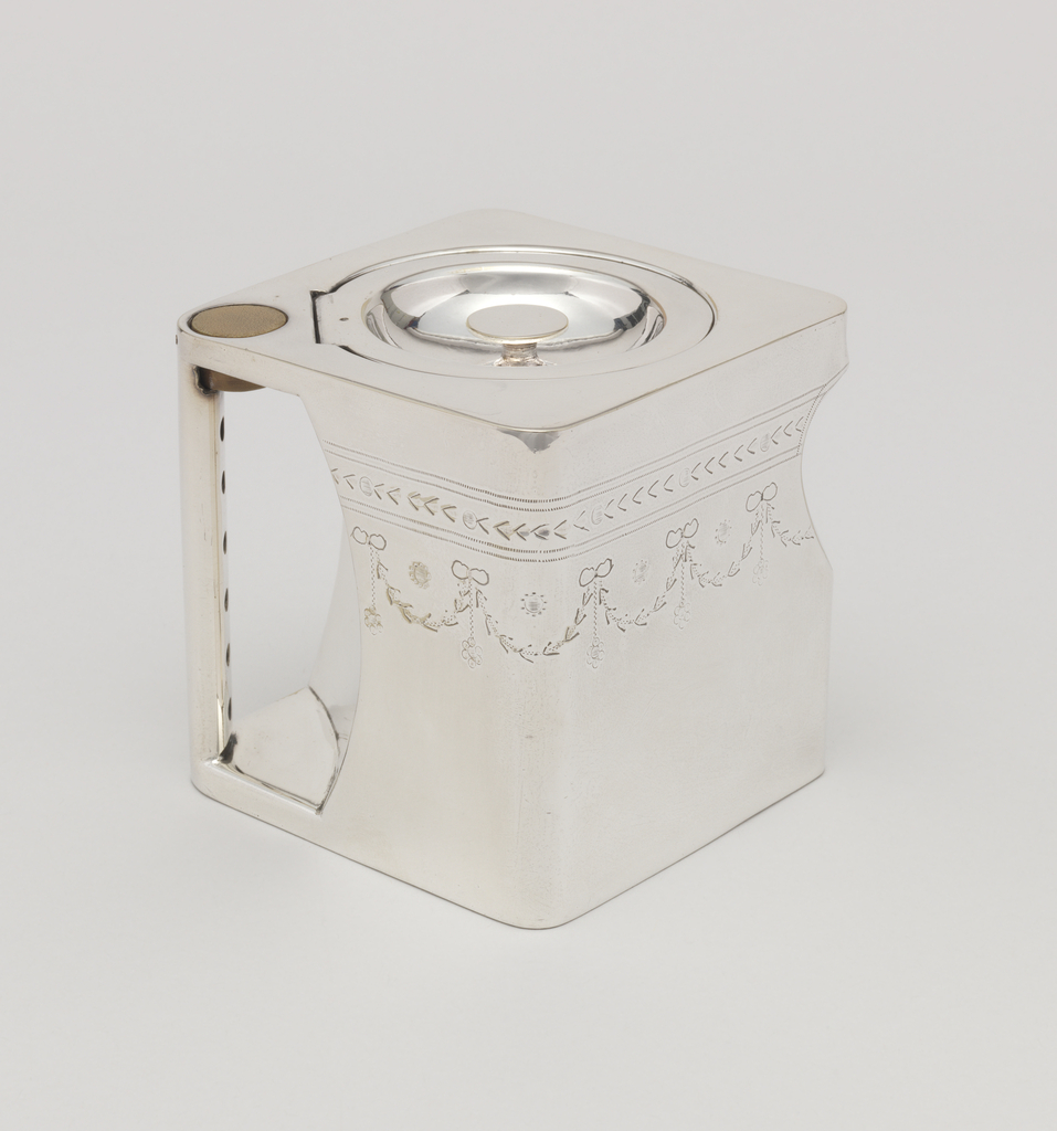 """Square """"cube"""" body, flat base and top. Flush hinged recessed circular cover set diagonally on top. Concave section at corner forms pouring spout. Opposite corner recessed to create handle aperture;handle vertical; wooden thumbrest inset at top; bright-cut engraved swags around body near top."""