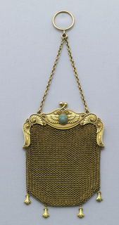 Small mesh purse with Egyptian revival motifs, including a winged, turquoise scarab beneath clasp, applied wire work and beading along frame, and four small pendants suspended from purse bottom.