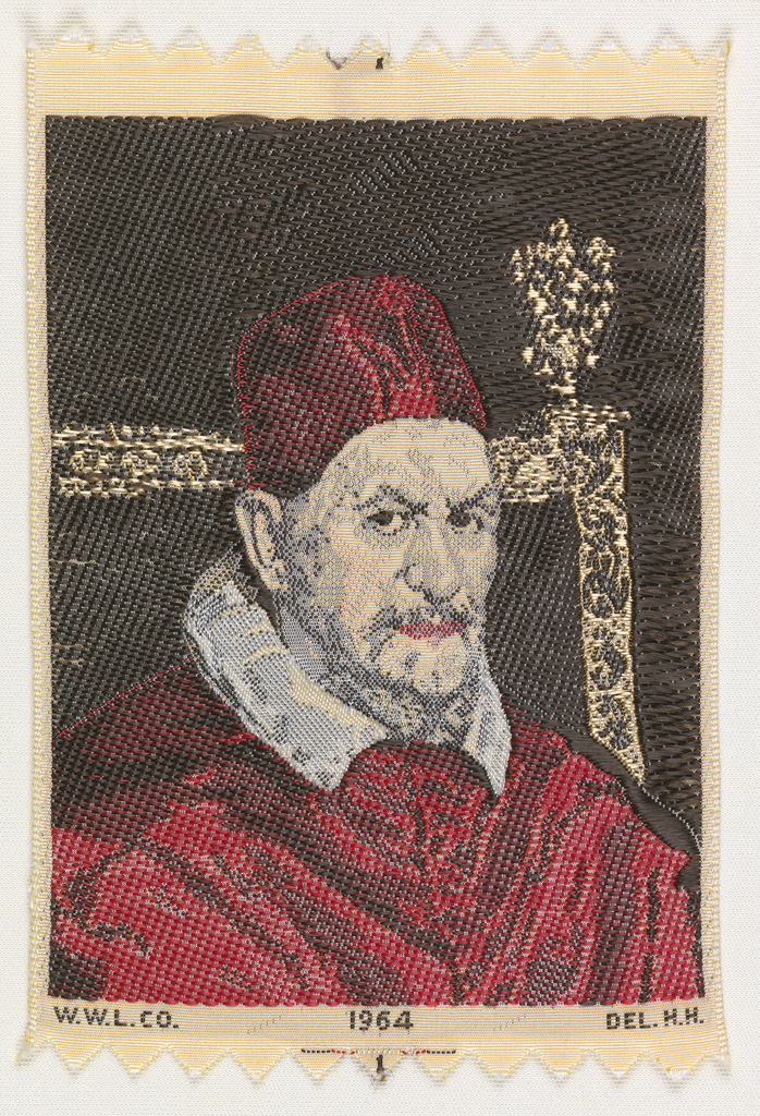 "Woven souvenir based on the painting 'Portrait of Pope Innocent X' (1650) by Diego Velázquez (1599–1660). ""W.W.L. CO. 1964 DEL. H.H."" appears below the portrait. ""W.W.L. CO."" represents Warner Woven Label Co.  Del H.H. is the designer's (Howard Huffsschmidt) initials. Red, black, and salmon on white warp."