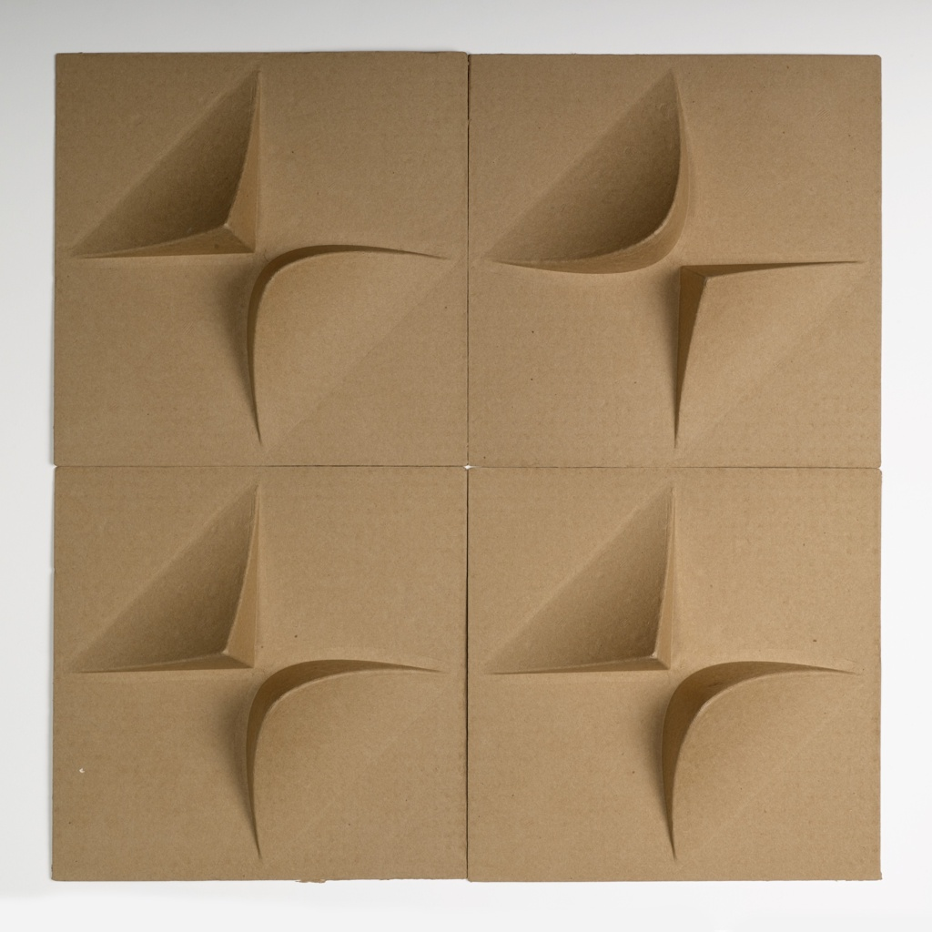 Square tiles embossed to a depth of 2.5 inches.  The embossing includes 2 protrusions in alternate corners, one triangular and one rounded.   The tiles are a natural brown in color and can be installed in many different patterns on the wall or ceiling. Produced from 100% post and pre-consumer recycled paper.