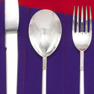 Five tine fork with concave bowl. Below the handle join, a one-inch-long double-reeded segment terminating in a canted notch extends on to the upper edge of the spreading rectangular square-ended handle.