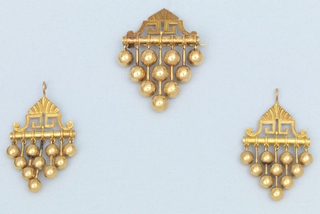 a) Earrings in design of bar surmounted by pointed ornament of Greek key and leaf; below bar are seven pendants (balls and rods) in four lengths.