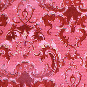 Scrolling acanthus pattern, with foliage forming repeating medallions. Printed in red and white on mauve ground.