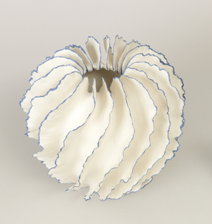 grey-white spiral-ruffles in extremely thin pinched porcelain with blue pigmented edges and biscuit exterior surrounding a narrow glazed opening