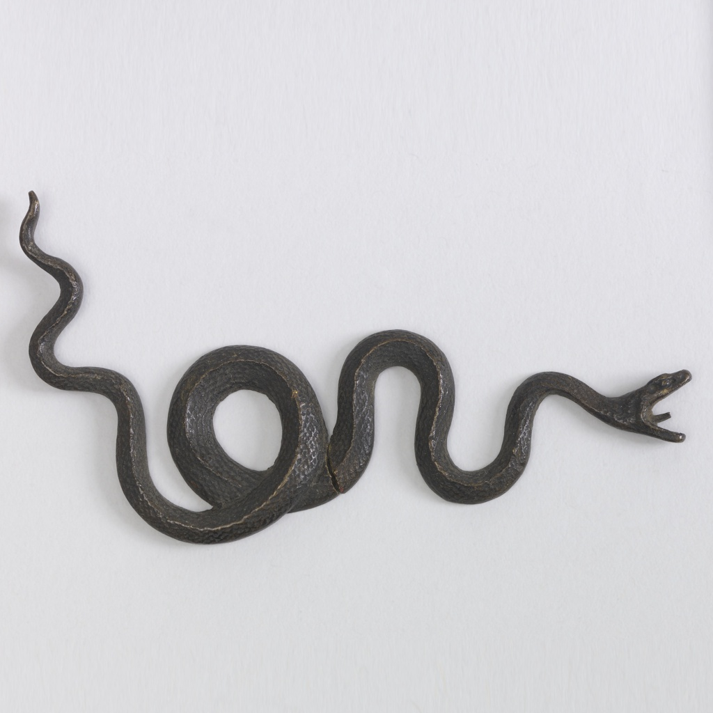 Coiled serpent with barbed tongue