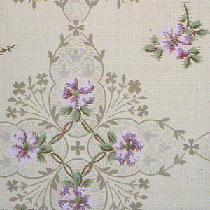 """Connected large and medium square floral medallions with five-petal pink flower motif and foliate vining. Light-yellow ground with dotted background. Printed in pinks, greens, beige and light grey. Printed in selvedge: """"Standard Papers""""."""