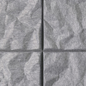 Gray, rigid, molded panel, the square face with rough, contoured, creased surface; the rough, flat sides flaring out slightly. On underside, at each edge, a hard, white, oblong felt block with black velcro for mounting.