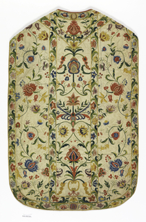 White wool plain cloth ground embroidered in design of floral serpentines with polychrome wools. Lined with glazed pink linen.