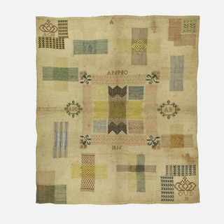 """Nine darning crosses, a darning corner, and a """"tear"""" corner; crowned initials at upper left, at lower right crowned """"oud 18"""" (18 years old)."""