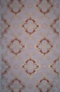 """Large foliate medallions with fleuron insets, floiate swags, and scrolls, connected by vining scrolls. Printed in pinks, red, gold mica.  Printed in selvedge: """"Standard Wall Paper Co"""" """"6272"""""""