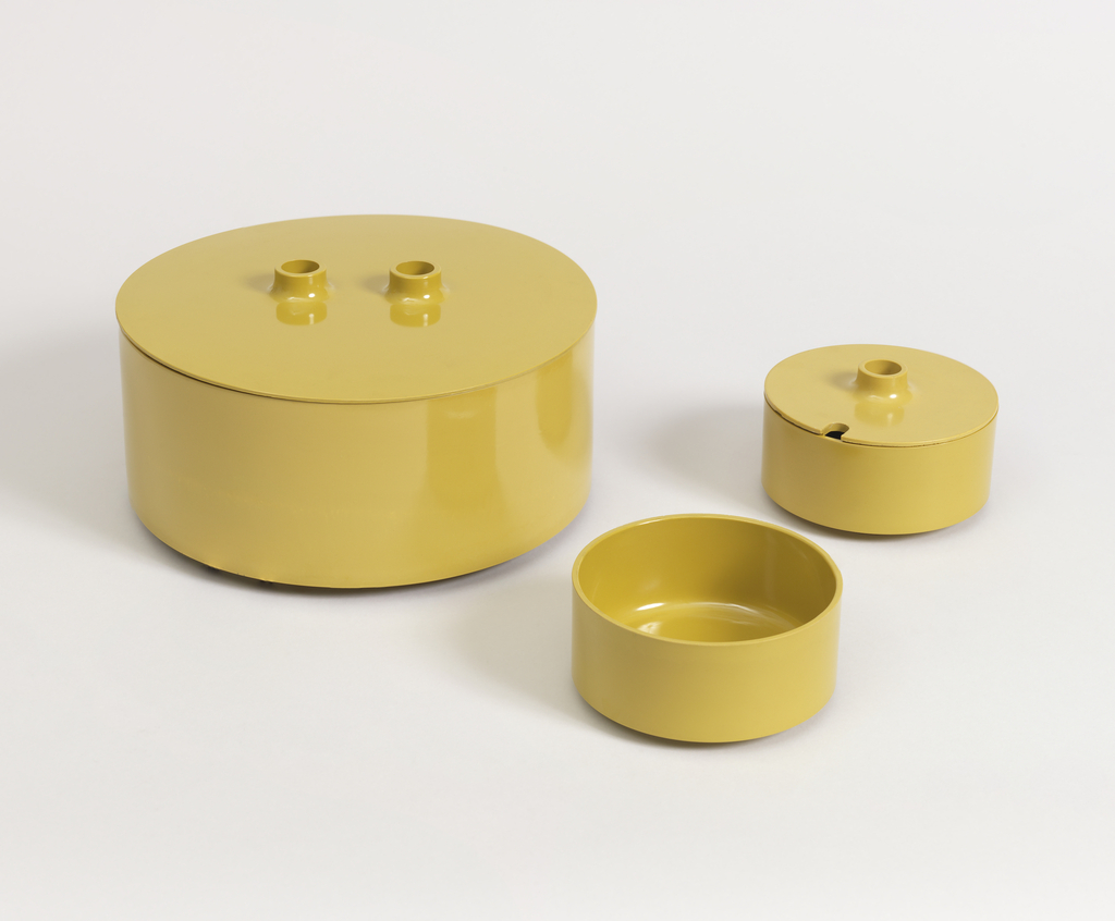 Mustard-yellow cylindrical serving bowl with circular lid.
