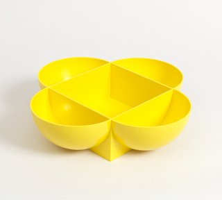 Molded bright yellow bowl with five compartments, formed of four open quarter spheres, linked together with square box in center.