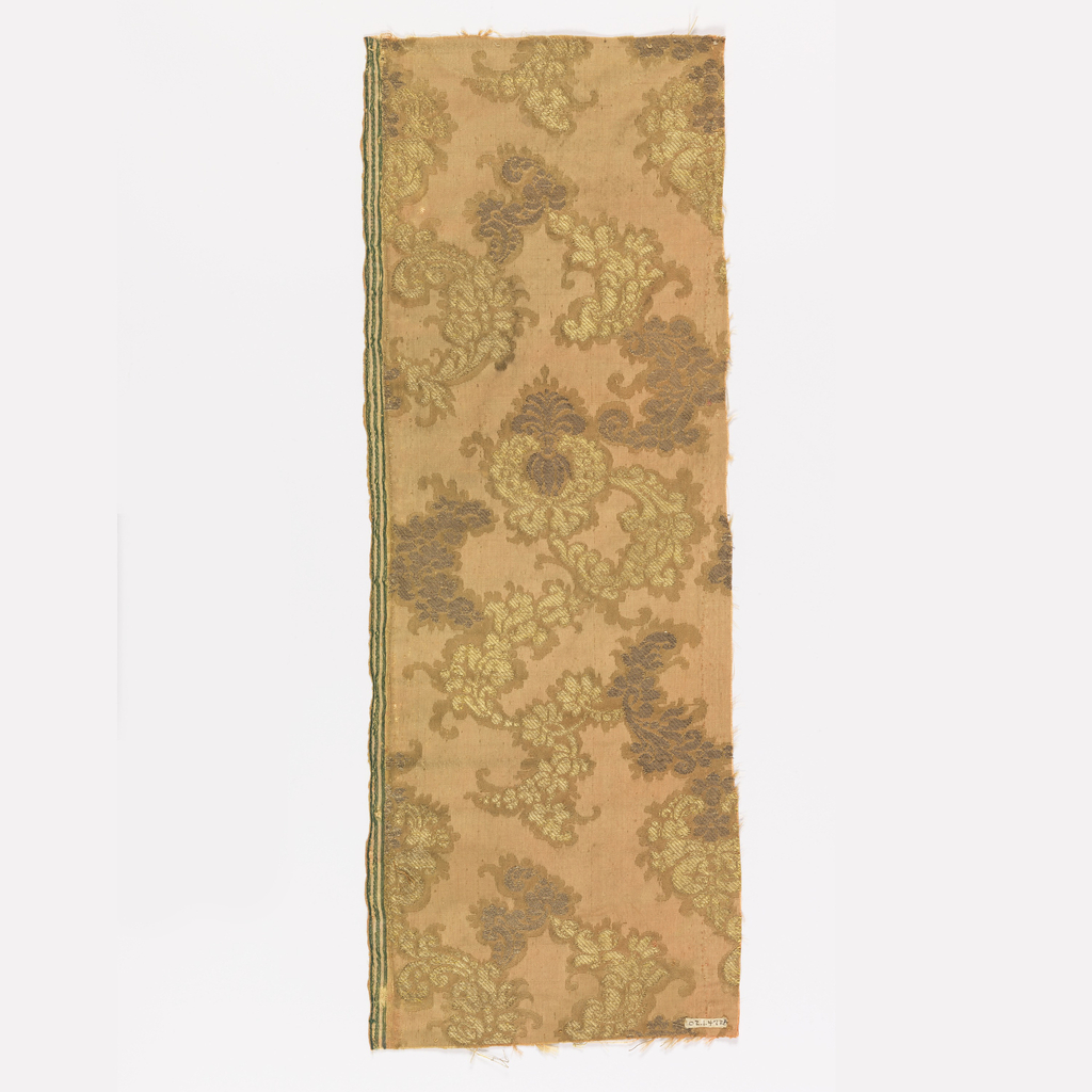 Tan ground with design of scrolling conventionalized leaves and palmettes.