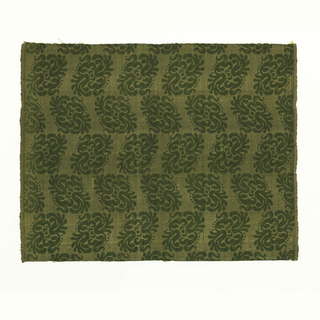 Diagonal green leaves on yellow background. Selvage on both sides.