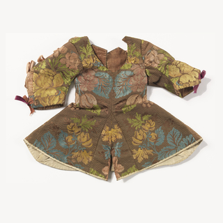 Garment of brown ribbed silk brocaded in a multicolored floral design. Lined with dark brown linen and hem faced with white silk taffeta. Open down the back and sleeves with linen tabs to fasten.