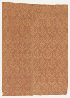 Fragment of rose and gold silk, ribbed and reversible, with a half-drop repeat of plant forms extending from open leafy scrolls.