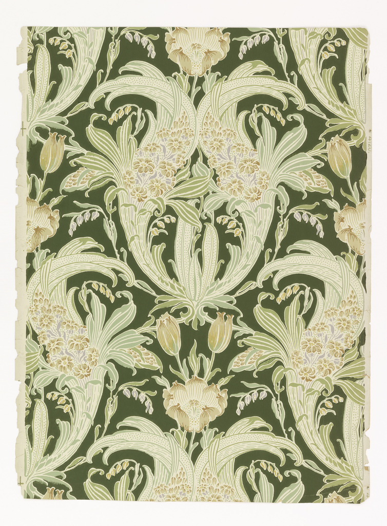 On beige ground, thin green stripe. Over this, floral pattern of lilies of the valley, tulips, and other flowers in creamy yellow, browns and lavenders. Foliage in shades of green with striping and dotting. Dark green over-printed background color.