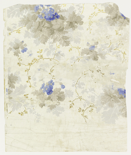 Vining floral design.  Clusters of foliage, printed in 8 colors: shades of taupe with light gray shadow effect, with blue flowers. Vining tendrils printed in metallic gold. Printed on a white satin ground.  This piece was cut from the roll end with a section of unprinted white satin ground.