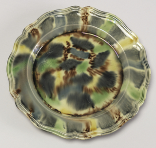 "Polychrome ""tortoise-shell"" decoration in brown, with yellow, green and blue-gray glazing on upper surface, and simple molded edge."