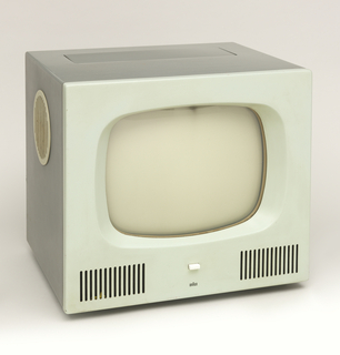 Gray, cube-form television; front of cabinet dominated by glass screen above small white rectangular button above the BRAUN logo flanked by vertical speaker grills on the left and right; cabinet sides with inset, circular white speakers; controls hidden under panel in top.