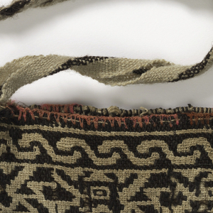 Woven bag that depicts rows of animals on one side. The other has a diamond shape with enclosed stars. Shoulder band in plain weave.