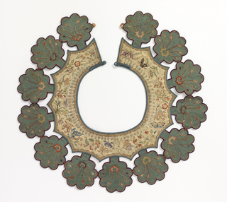 "Cream colored silk collar affixed with thirteen green silk ""cloud"" pendants, each with eight petals. Embroidered with polychrome silk and couched gold showing flowers and butterflies."