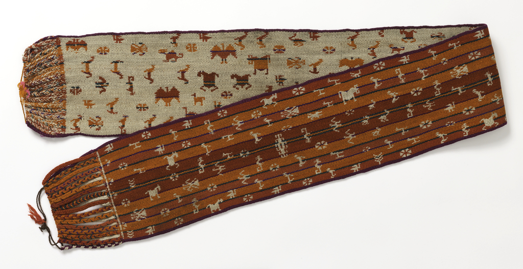 Predominantly red and orange striped belt with a random pattern of small animals and flowers in white. Reverse shows animals and flowers in striped colors on a white ground. Warp ends braided.