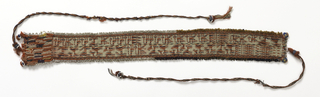 Long, narrow band patterned by small geometric animals, birds and plant forms in ivory, red, purple and yellow. Beads attached to both sides. One end has tapestry-woven tab fringe sewn together.